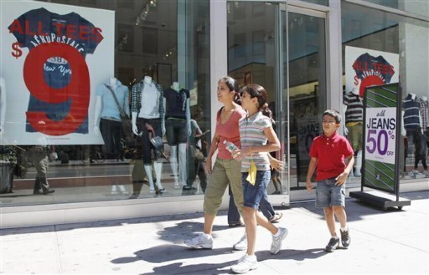In this July 30, 2010 photo, Rajni Gupta and her children Anooshka, 10, and Kiril, 7, leave Aeropostale after shopping for back-to-school clothes, in New York. The U.S. service sector, the nation's predominant job generator, expanded for the eighth straight month in August although the pace of growth slowed, according to a trade group survey. (AP Photo/Mark Lennihan)