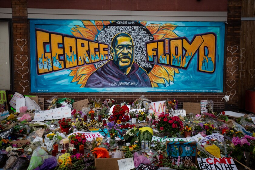 A makeshift memorial and mural outside a store in Minneapolis where George Floyd died during an arrest by police.