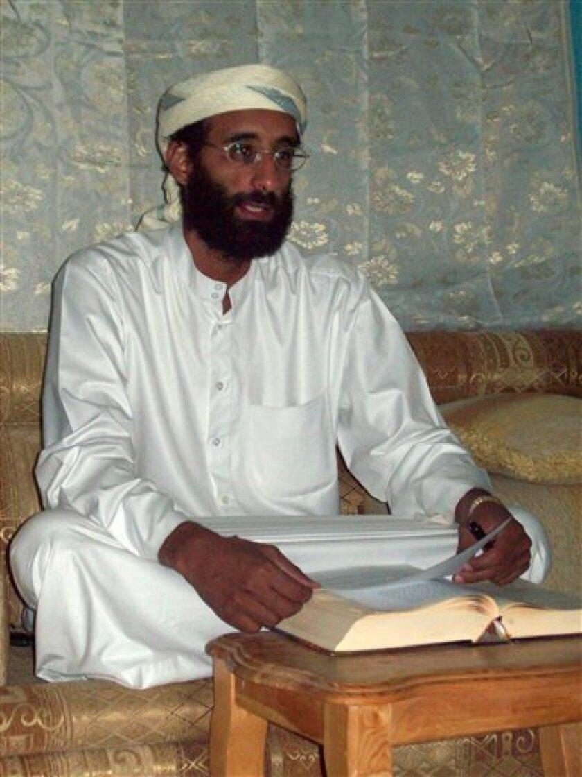 File - This Oct. 2008 file photo by Muhammad ud-Deen shows Imam Anwar al-Awlaki in Yemen. Yemen's deputy prime minister Rashad al-Alimi says Umar Farouk Abdulmutallab, the Nigerian accused of trying to blow up a U.S. passenger jet on Christmas, may have met in Yemen with Anwar al-Awlaki, a radical American-Yemeni cleric linked to al-Qaida and the alleged Fort Hood shooter U.S. Maj. Nidal Malik Hasan. (AP Photo/Muhammad ud-Deen, File)