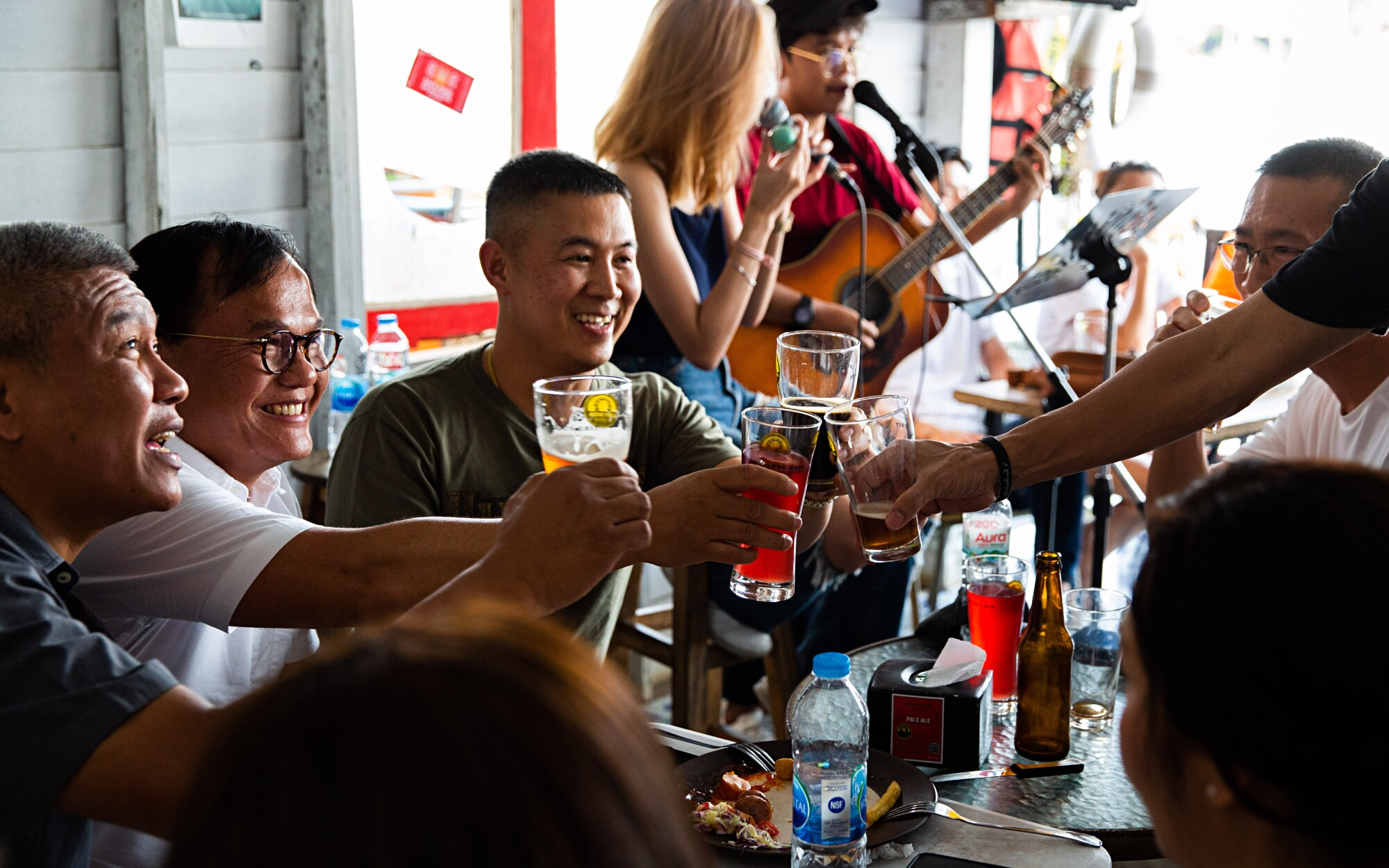 Patrons enjoy a beer at Chit Beer, a craft brewery on Koh Kret island upriver from Bangkok, Thailand.