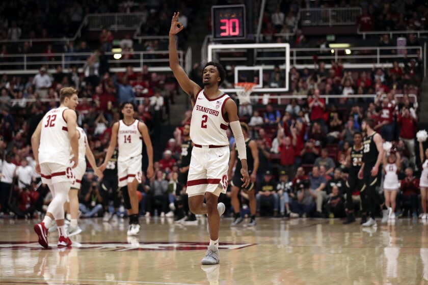 Stanford guard Bryce Wills (2) celebrates after a three-point basket against Colorado during the second half of an NCAA college basketball game in Stanford, Calif., Sunday, March 1, 2020. (AP Photo/Jed Jacobsohn)
