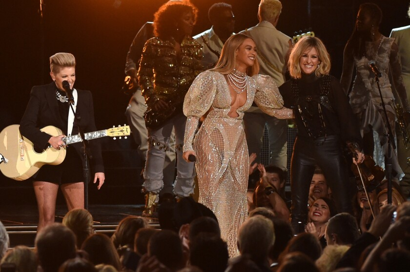 Beyoncé performs with Natalie Maines, left, and Martie Maguire of the Dixie Chicks at Wednesday's CMA Awards.
