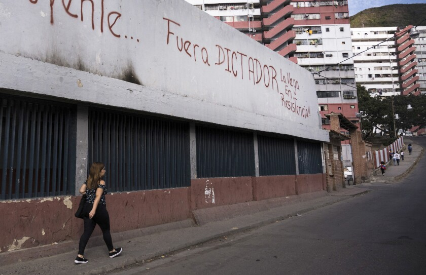 """Oust the dictator-La Vega is in resistance"" reads graffiti in La Vega, an impoverished area of Caracas and a former stronghold of the Venezuelan leftist party."