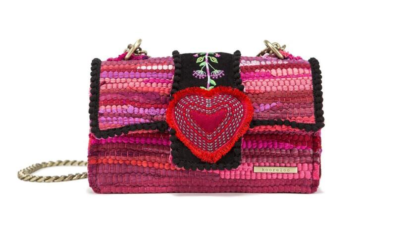 Kooreloo: Kooreloo's Divine Bijoux Fuschia handbag is woven of multi-colored fabric, has floral emb