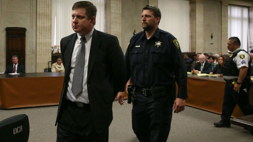 Chicago Police Officer Jason Van Dyke, left, is escorted from the courtroom Friday after being found guilty of murder and aggravated battery in the shooting death of Laquan McDonald.
