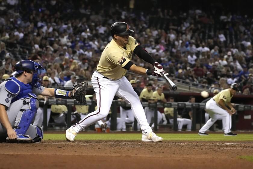 Asdrúbal Cabrera, de los Diamondbacks de Arizona, en el partido contra los Dodgers de Los Ángeles el viernes 30 de julio de 2021, en Phoenix. Arizona ganó 6-5. (AP Foto/Rick Scuteri)