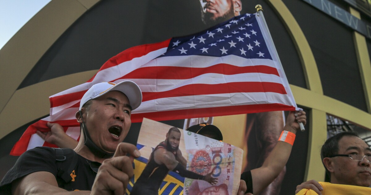 Hong Kong supporters gather before Lakers-Clippers game - Los Angeles Times