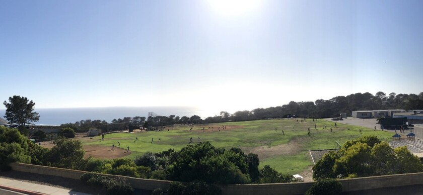 The Del Mar Heights field in use by football and baseball teams on a weekday afternoon.