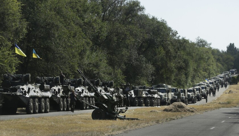 A Ukrainian armored column parks on the roadside Wednesday while preparing to reinforce Mariupol, a vital Ukrainian port on the Sea of Azov where Russian forces appear to have opened a new front in the separatist war against Kiev.