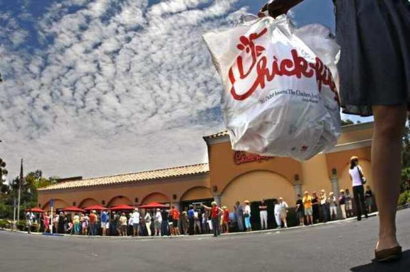 A Tuscon executive is out a job after recording his confrontation with a Chick-fil-A employee. Above, hundreds of customers line up at a Chick-fil-A restaurant in Laguna Niguel.
