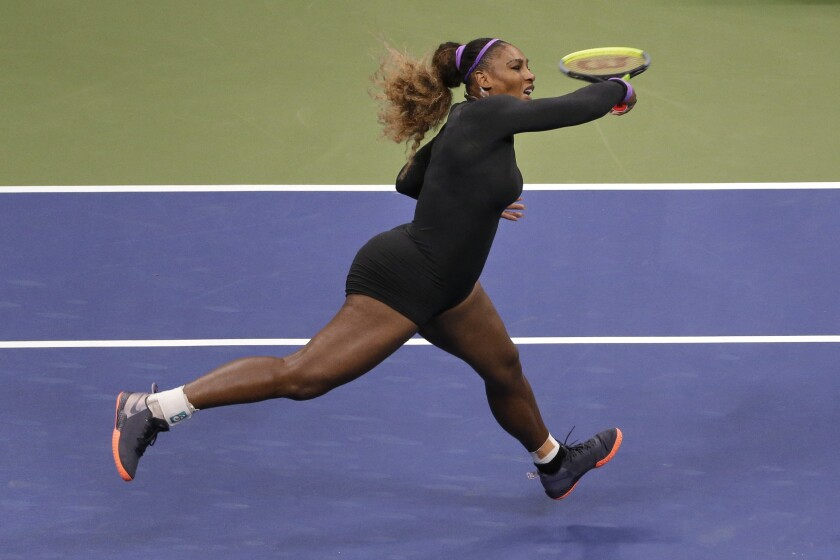 Serena Williams follows through on a forehand during her victory over Wang Qiang on Tuesday.