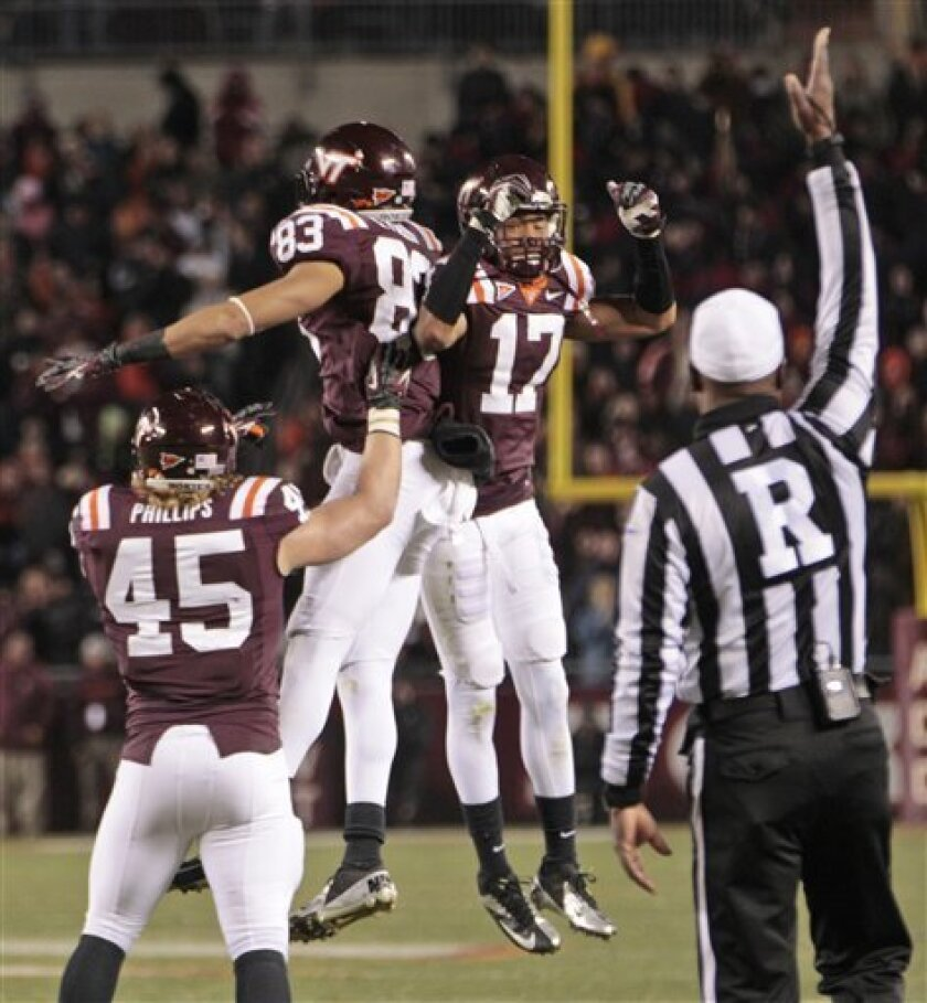 Virginia Tech wide receiver Corey Fuller (83) celebrates a touchdown with cornerback Kyle Fuller (17) and fullback Joey Phillips (45) during the first half of an NCAA college football game against Florida State in Blacksburg, Va., Thursday, Nov. 8, 2012. (AP Photo/Steve Helber)