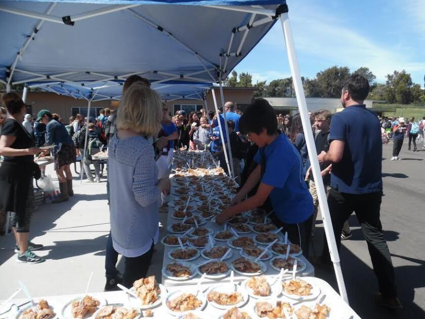 "Earl Warren students are shown participating in a variety of 'Pi Day"" activities."