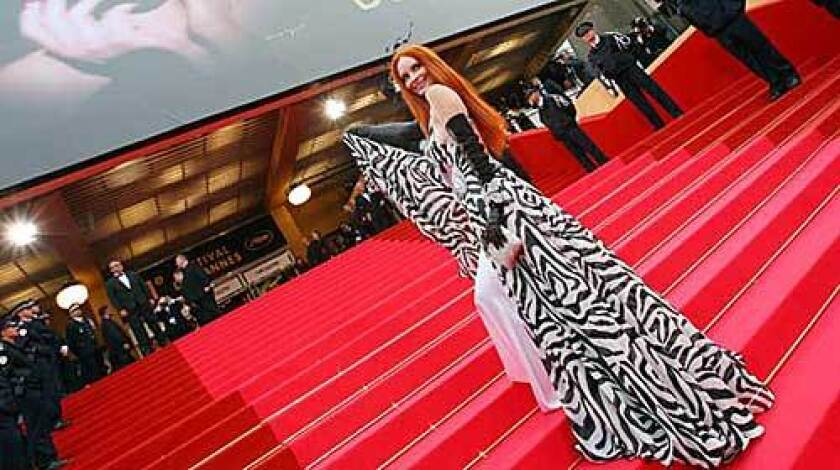 Phoebe Price in a floor-length black and white gown at the screening of Woody Allen's new film.