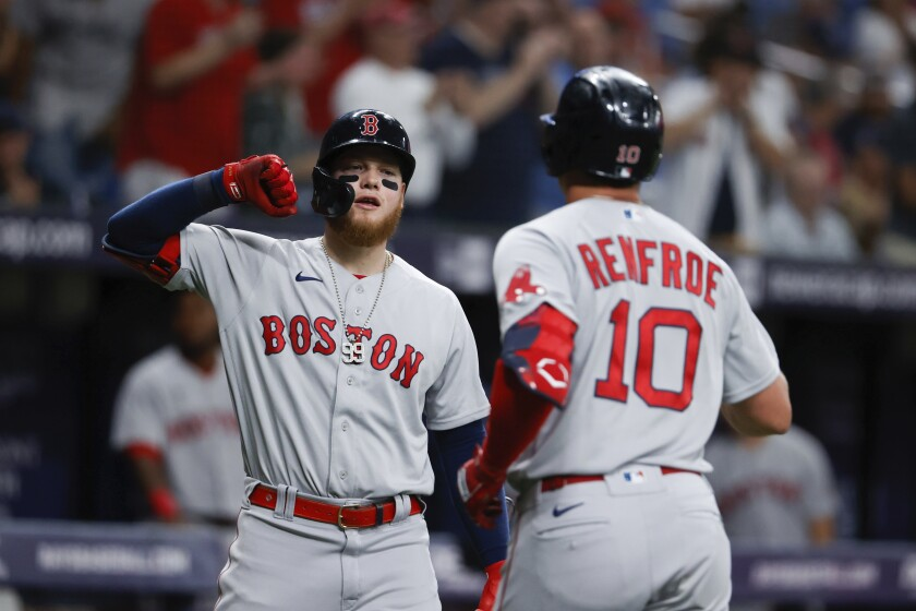 Boston Red Sox right fielder Hunter Renfroe (10) celebrates his home run against the Tampa Bay Rays with teammate Christian Vazquez (7) during the fourth inning of a baseball game, Sunday, Aug. 1, 2021, in St. Petersburg, Fla. (AP Photo/Scott Audette)