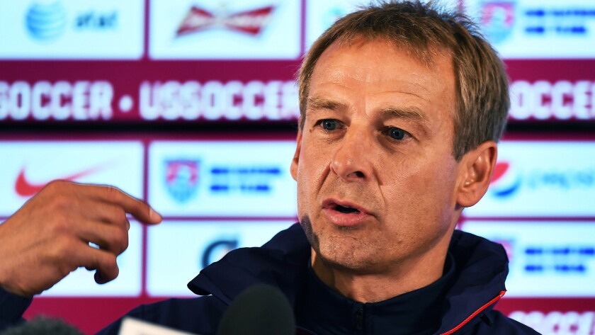 U.S. Coach Juergen Klinsmann says it would be unrealistic to think the team has a legitimate shot at winning the World Cup this year.