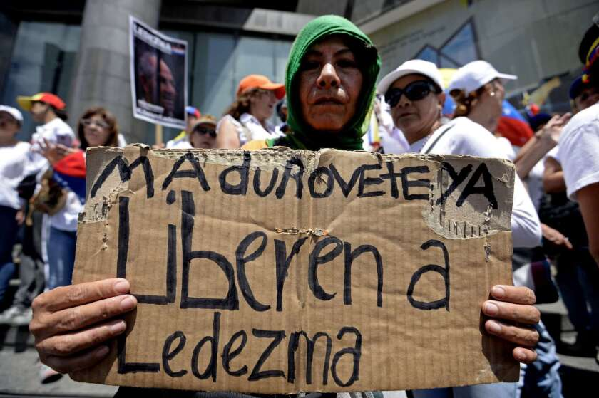 An opponent of the government of Venezuelan President Nicolas Maduro takes part in a march in Caracas to mark International Women's Day.