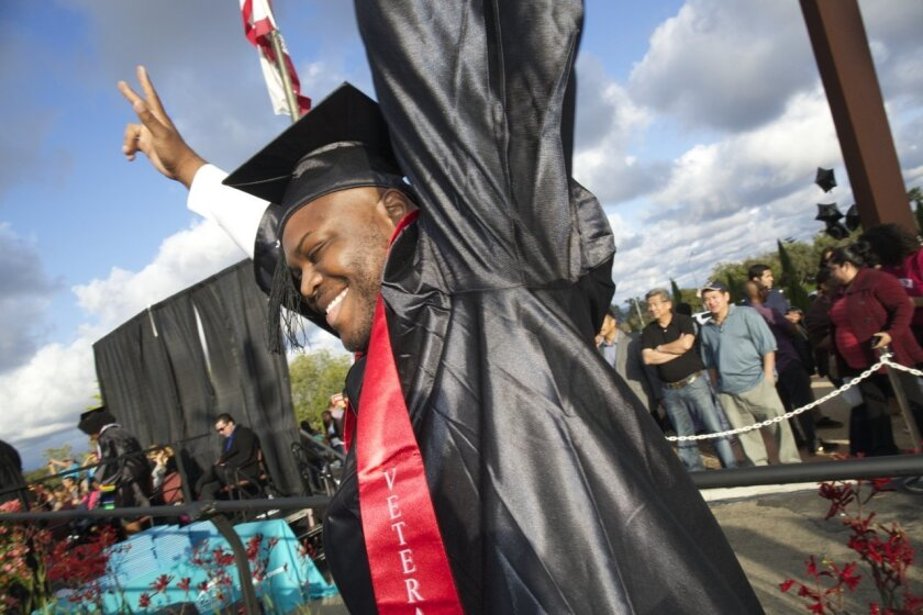 Student and veteran Deverson Lochard celebrates during his graduation from MiraCosta College.