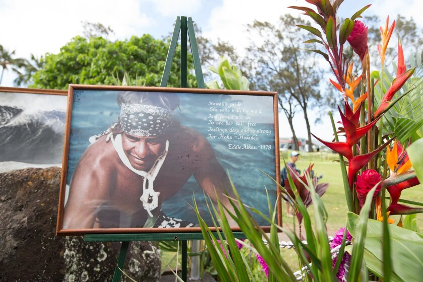 This Dec. 3, 2015 photo provided by Quiksilver shows a shrine with a photograph of big wave surfer Eddie Aikau at Waimea Bay near Haleiwa, Hawaii, during the official opening ceremony of the the Quiksilver In Memory of Eddie Aikau big wave competition. Event organizers say the competition will take