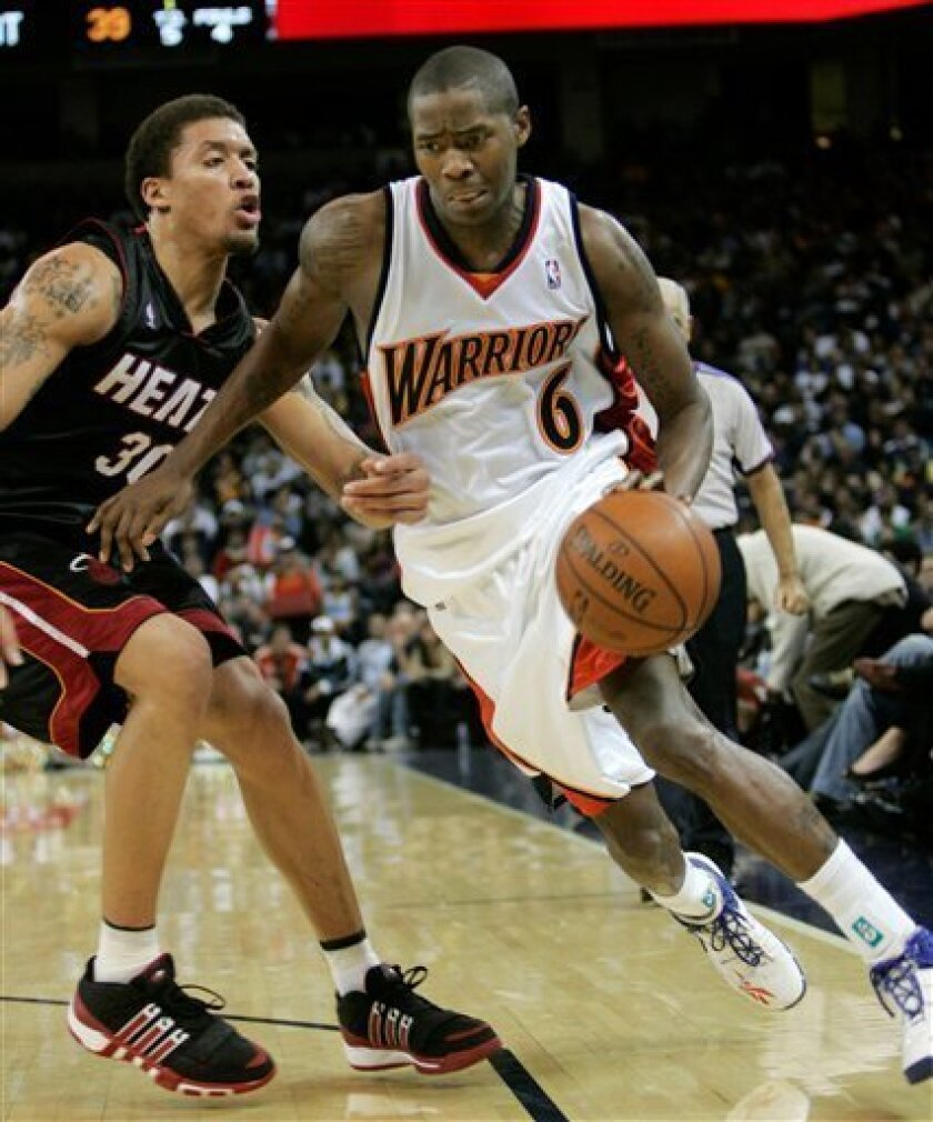 Golden State Warriors guard Jamal Crawford (6) dribbles past Miami Heat forward Michael Beasley (30) during the first half of an NBA basketball game in Oakland, Calif., Monday, Dec. 1, 2008.(AP Photo/Marcio Jose Sanchez)
