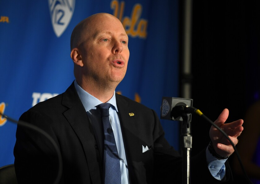 UCLA coach Mick Cronin speaks at a news conference.