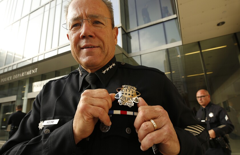 LAPD Chief Michel Moore wears his 150th anniversary badge during the unveiling at police headquarters. About 2,000 officers will wear a nearly identical badge of those worn by officers in 1869.