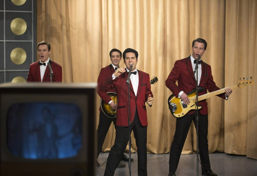"This photo released by Warner Bros. Pictures shows, from left, Erich Bergen as Bob Gaudio, Vincent Piazza as Tommy DeVito, John Lloyd Young as Frankie Valli and Michael Lomenda as Nick Massi in Warner Bros. Pictures' musical ""Jersey Boys,"" a Warner Bros. Pictures release. (AP Photo/Courtesy Warner Bros., Keith Bernstein)"