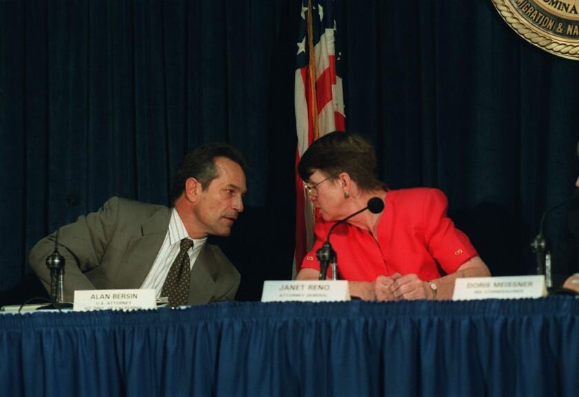 Then-U.S. Atty. Gen. Janet Reno and then-U.S. Atty. Alan Bersin talk Operation Gatekeeper on Oct. 14, 1995.
