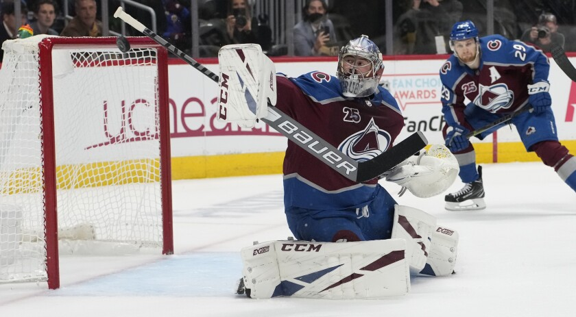 FILE - Colorado Avalanche goaltender Philipp Grubauer (31) watches the puck in the first period of Game 5 of an NHL hockey Stanley Cup second-round playoff series in Denver, in this Tuesday, June 8, 2021, file photo. Several goaltenders were on the move in NHL free agency Wednesday, July 28, 2021. Vezina Trophy finalist Philipp Grubauer left Colorado for the expansion Seattle Kraken. (AP Photo/David Zalubowski, File)