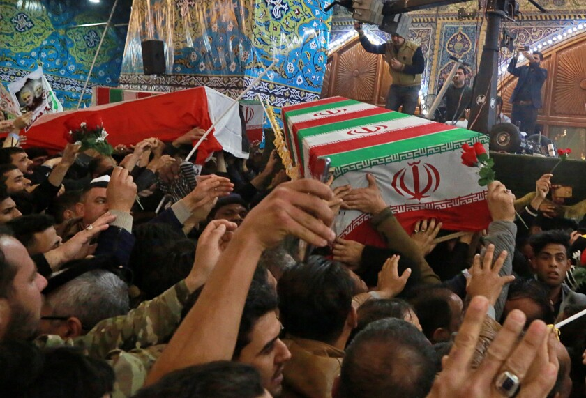 Mourners carry the coffins of Qassem Suleimani, Iran's top general, and Abu Mahdi Muhandis, deputy commander of the Popular Mobilization Forces in Iraq, during their funeral Jan. 4 in Karbala, Iraq.