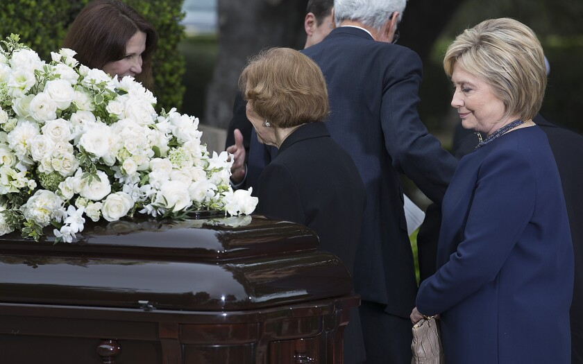Hillary Clinton pauses before Nancy Reagan's casket at the former first lady's funeral in Simi Valley this month.