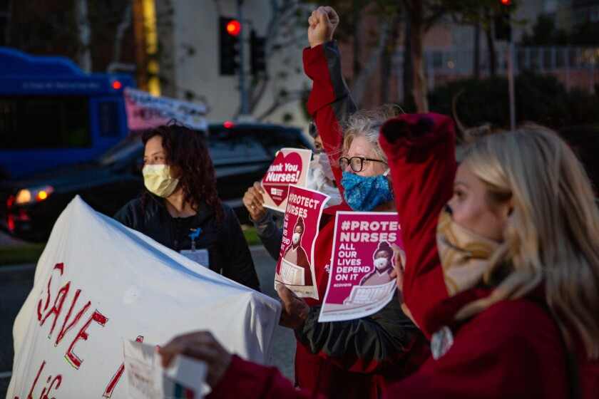 Nurses gather to protest the lack of personal protective equipment at the UCLA Ronald Reagan Medical Center in Los Angeles on Thursday, April 16, 2020.