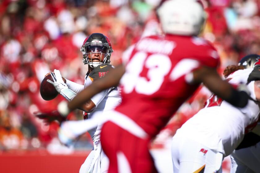 Tampa Bay Buccaneers quarterback Jameis Winston looks to pass against the Arizona Cardinals.
