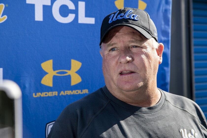 UCLA coach Chip Kelly talks to reporters prior to practice Aug. 14 in Westwood.