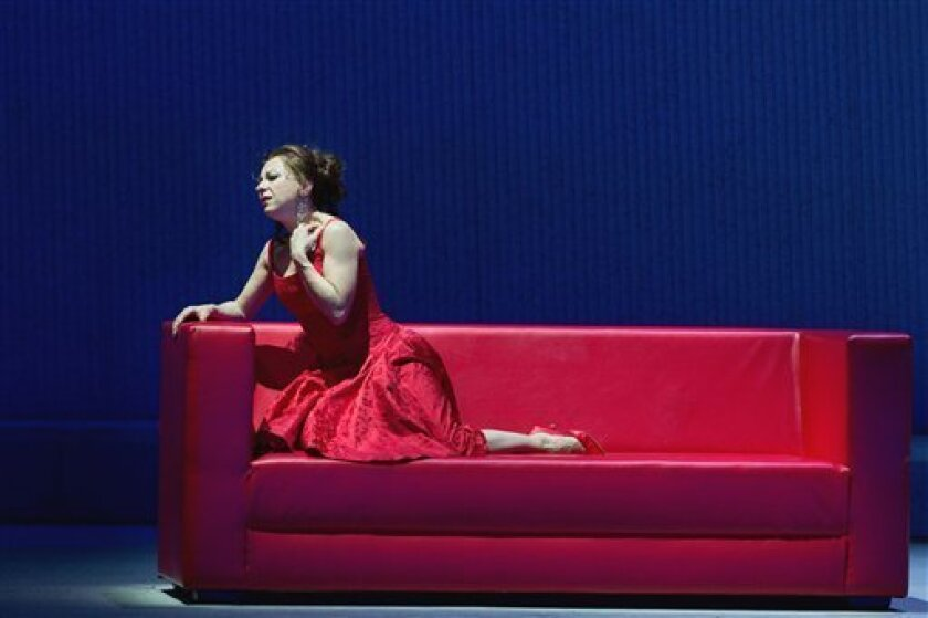 "In this Friday, March 30, 2012 photo provided by the Metropolitan Opera, Natalie Dessay plays Violetta in a dress rehearsal of Verdi's ""La Traviata,"" at the Metropolitan Opera in New York. (AP Photo/Metropolitan Opera, Marty Sohl)"