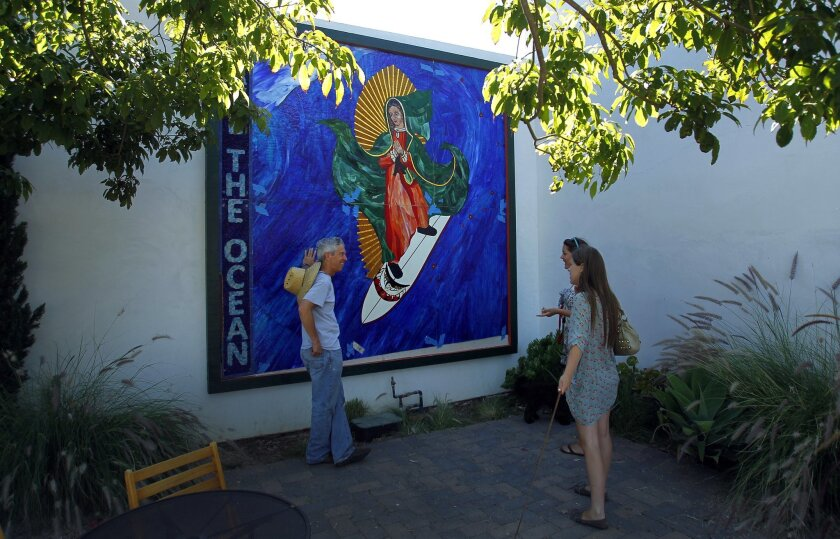 Artist Mark Patterson created the Surfing Madonna in 2011. Now the artwork might be removed from its public viewing space.