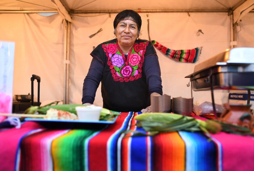 LOS ANGELES, CALIFORNIA MAY 24, 2018-Sidewalk vendor Merced Sanchez stands at her food booth at the