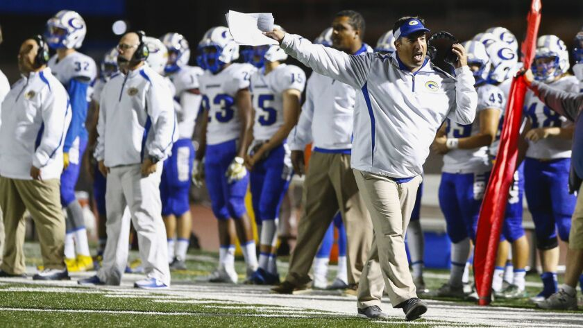 Grossmont head coach Tom Karlo motions from the sidelines during the second half against Madison.