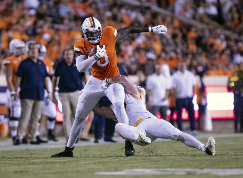 Virginia tight end Jelani Woods (0) is tackled by a William & Mary player during an NCAA college football game Saturday, Sept. 4, 2021, in Charlottesville, Va. (Erin Edgerton/The Daily Progress via AP)