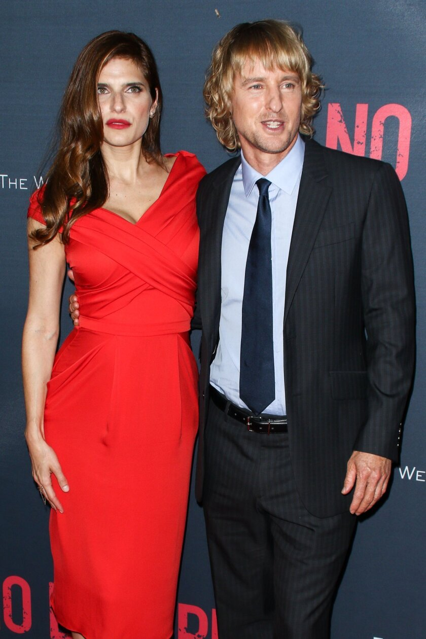 """Lake Bell, left, and Owen Wilson attend the LA Premiere of """"No Escape"""" held at Regal Cinemas L.A. LIVE on Monday, Aug. 17, 2015, in Los Angeles. (Photo by John Salangsang/Invision/AP)"""