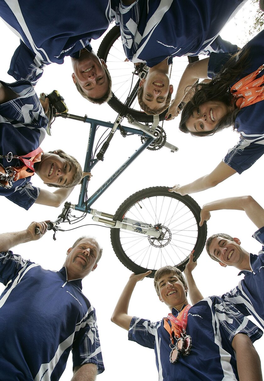 The Ramona High cycling team, with coach Robert Grace (lower left) competes in the SoCal High School Racing League.