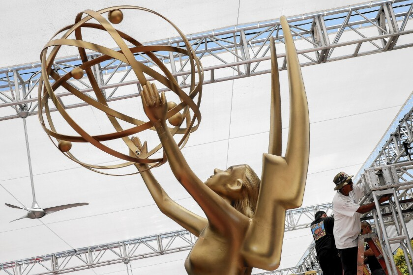 Crews set up the red carpet area at Nokia Theatre for TV's big night tonight, the Emmy Awards.