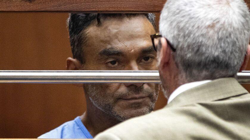 LOS ANGELES, CA - SEPTEMBER 26, 2018: Ramon Escobar, 47, talks with his public defender during his