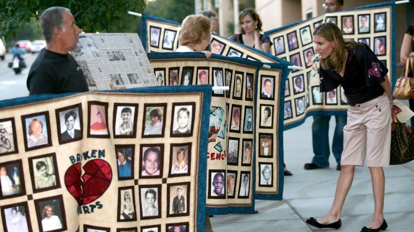Photos of alleged victims of sexual abuse by Catholic priests, during a protest by the Survivors Network of those Abused by Priests in Los Angeles on Sept. 27, 2006.