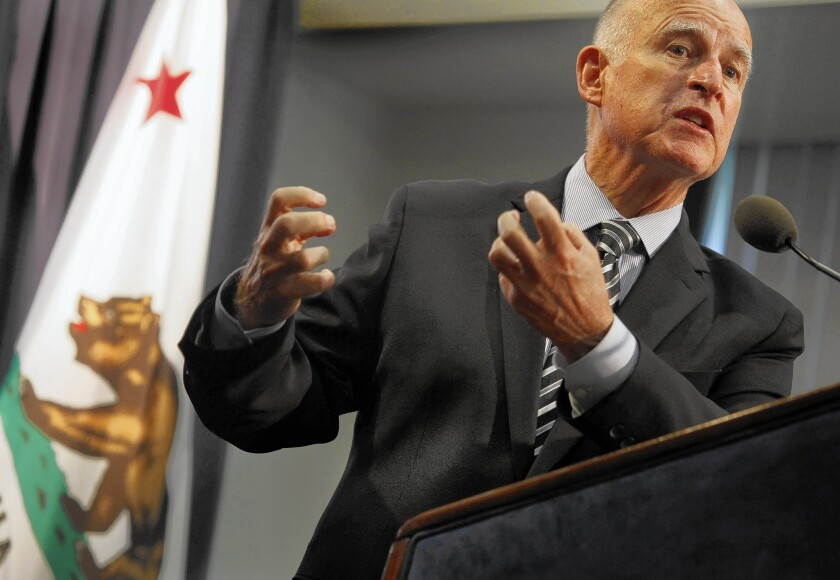 Gov. Jerry Brown, here speaking in Los Angeles in September, is using Propositions 1 and 2 as his main vehicle for seeking an unprecedented fourth term, campaigning not as an incumbent asking voters to let him stay, but as a sitting governor focused on the state's needs.