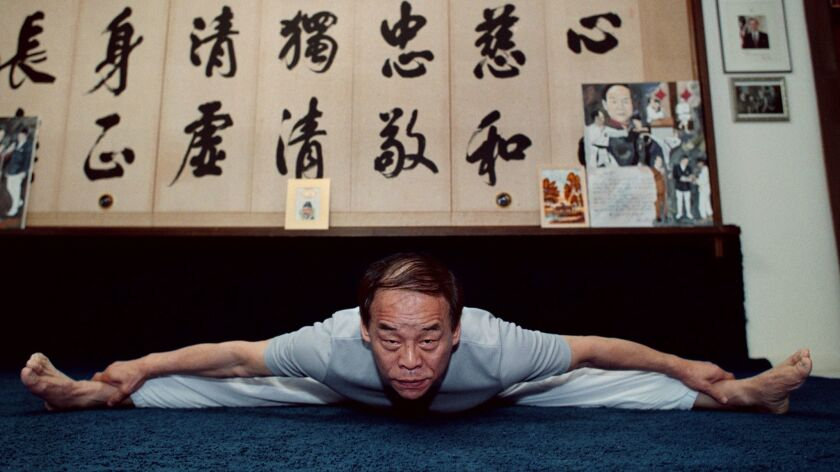 Jhoon Rhee in 2002, during his morning workout at home in McLean, Va. MUST CREDIT: Washington Post p