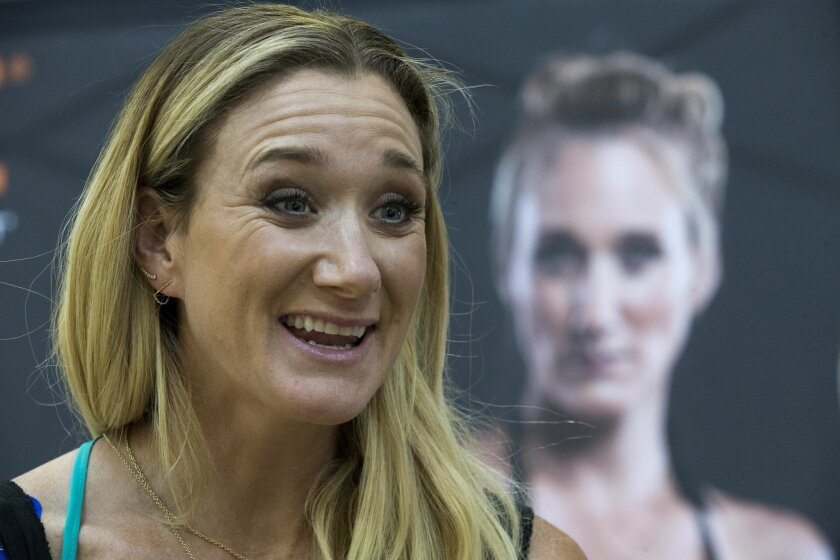 Kerri Walsh Jennings speaks to reporters during a news conference sponsored by KT Tape, Tuesday, March 22, 2016, in New York. Jennings says she's pain-free after testing her surgically-repaired shoulder during two weeks of beach volleyball matches in Brazil. (AP Photo/Mary Altaffer)
