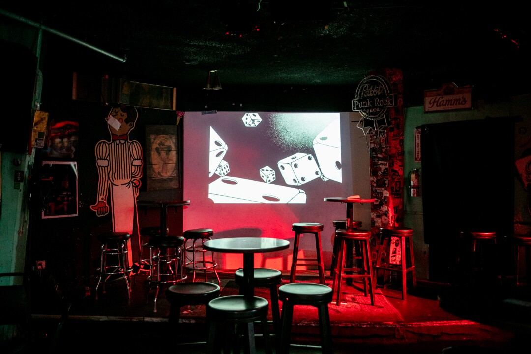 Rolling dice play in the credits of a movie inside The Tower Bar on June 29, 2020 in San Diego, California.