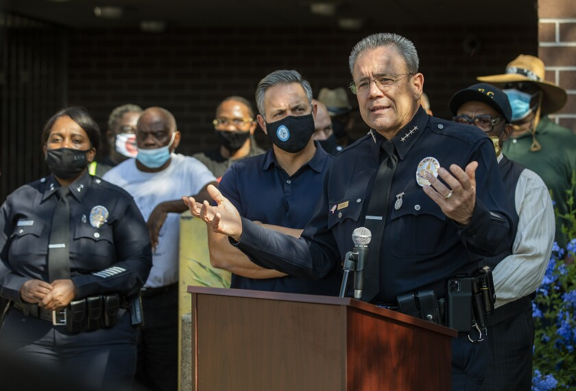 LAPD Police Chief Michel Moore, right, addresses the media in October.