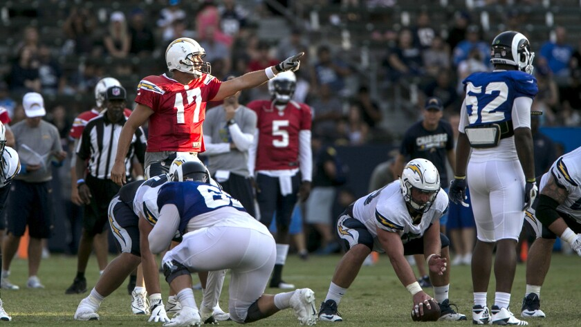 Quarterback Philip Rivers sets the Chargers offense during a practice with the Rams on Saturday at StubHub Center.